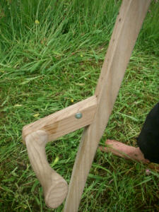 The short stemmed right hand grip on the scythe set up for mowing in the hay meadow